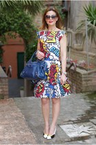 yellow comics print Moschino dress - blue city balenciaga bag