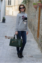 silver Moschino sweater - black guess by marciano boots - blue MORGAN jeans