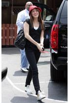 black bag - skinny jeans - red hat - black top - white sneakers