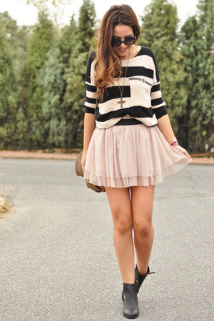 black boots - neutral skirt