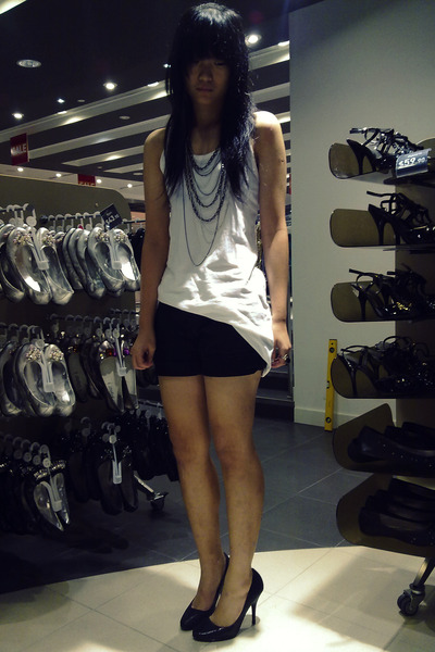 white top - black shorts - black shoes - silver necklace