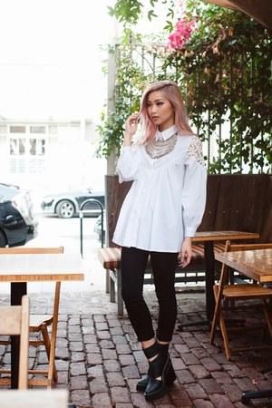 black boots - black jeans - white top