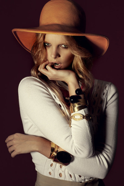 carrot orange floppy hat - cream cut-outs sweater - black chunky bracelet - ligh
