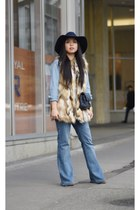 light brown faux fur Zara vest - navy quilted Chanel bag