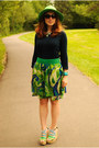 Green-hat-navy-gap-sweater-green-patterned-skirt
