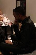 black leather jacket - black biker sunglasses - black pants - silver earrings