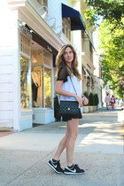black vintage Chanel bag - black faux leather H&M shorts