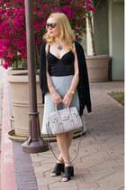 black cardigan madewell sweater - light blue a line Prada skirt