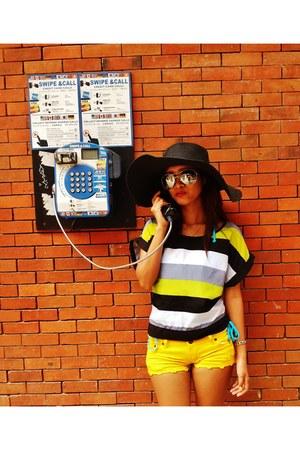 black floppy hat - yellow short shorts - black aviator sunglasses