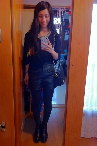 black Moschino bag - navy sweater - black leather shorts shorts