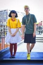 yellow shoes - green polo shirt - gold shirt - dark brown tights - black shorts