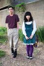 Purple-blouse-black-boots-beige-pants-green-dress