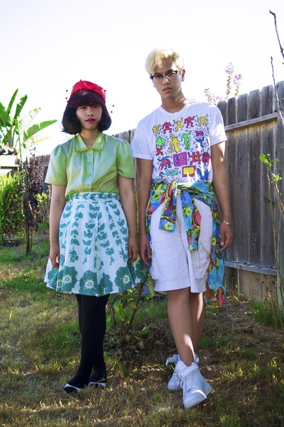 red hat - white keith haring shirt - sky blue shirt