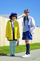 yellow coat - light blue shirt - blue shorts - navy skirt