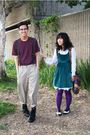 Purple-blouse-black-boots-beige-pants-green-dress