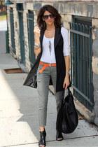 black vest - black bag - carrot orange belt - olive green cargo pants