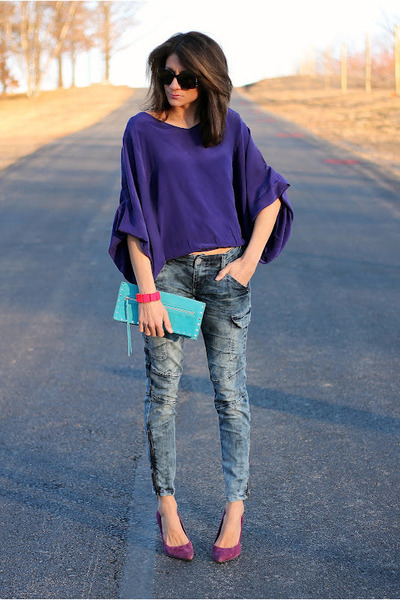 purple shirt and blue jeans