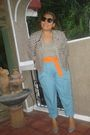 Black-blazer-silver-top-blue-pants-orange-belt-gray-shoes
