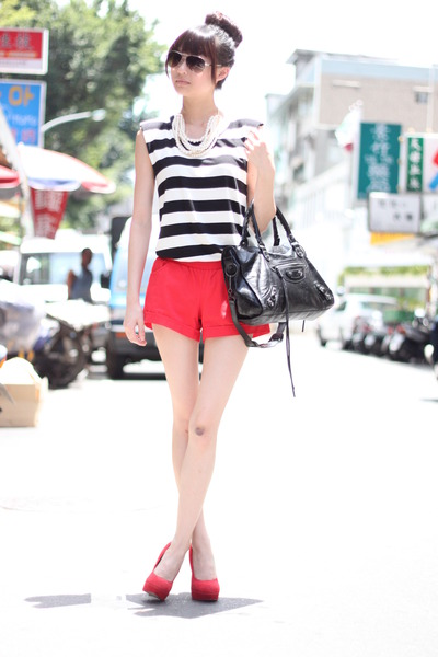 white top - black bag - red shorts