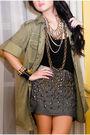 Green-zara-jacket-blue-trunkshow-skirt-black-from-rockwell-bazaar-boots-bl