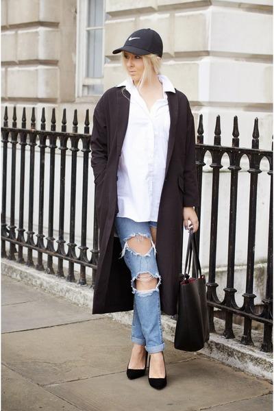 black cap nike hat - navy Boohoo jeans - black duster asos jacket
