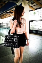 black bag - black shorts - peach top