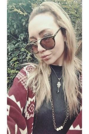 black Gucci sunglasses - crimson poncho jacket - black top