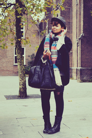 black coat - black shoes - black stockings - black bag - gray skirt - beige scar