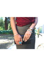 Tan-chevron-print-bebe-skirt-black-clutch-lancaster-paris-bag