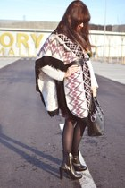 ivory poncho unknown jacket - black leather boots Hoegl boots