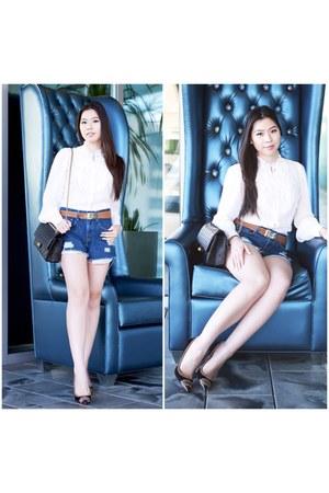 blue cutoff Levis shorts - black reissue Chanel bag