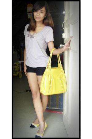 gray top - black shorts - yellow purse - yellow shoes