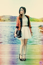 Carrot-orange-blazer-black-bag-beige-skirt