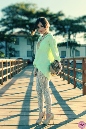 light blue blouse - tan pants - bronze necklace - eggshell heels