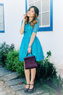 Sky-blue-dress-crimson-bag-crimson-pumps