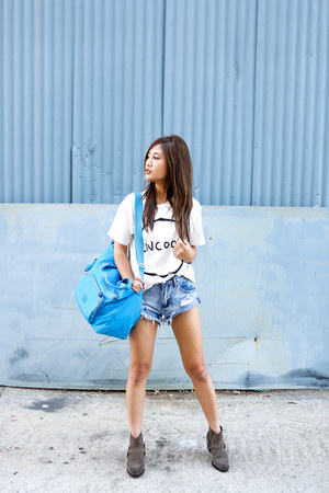 ankle boots All Saints boots - tote Kipling bag - high-waisted Nasty Gal shorts