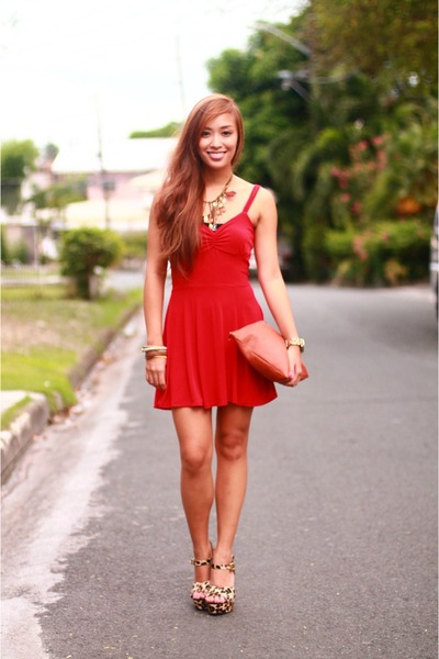 Happy Girl In Red Dress Wearing Black Shoes With Paper Bags