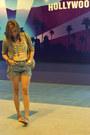 Light-brown-knitted-blazer-brown-bag-blue-shorts-blue-sandals-cream-top