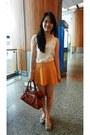 Tan-shoes-carrot-orange-balenciaga-bag-white-top-gold-top