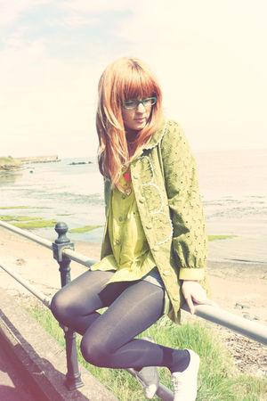 green coat - green shirt - blue shorts