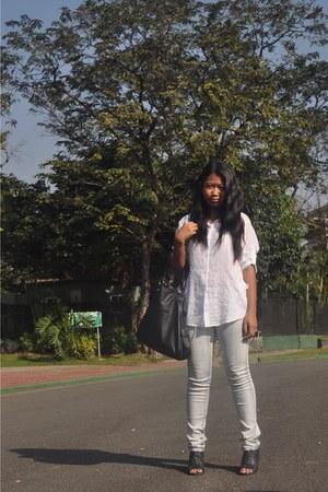 black shoes - jeans - white random brand shirt - black bag