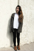 light brown suede Minnetonka boots - black basic leggings
