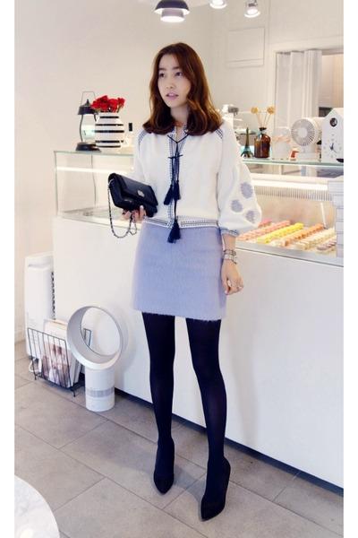 White Cardigan Black Skirt 60
