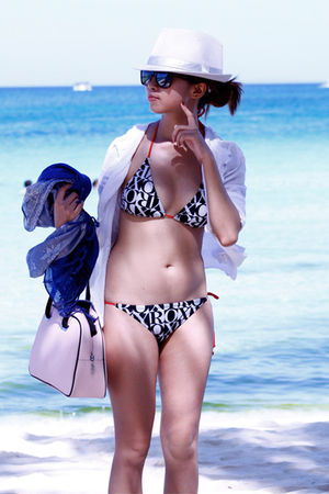 swimwear - top - - hat - - glasses