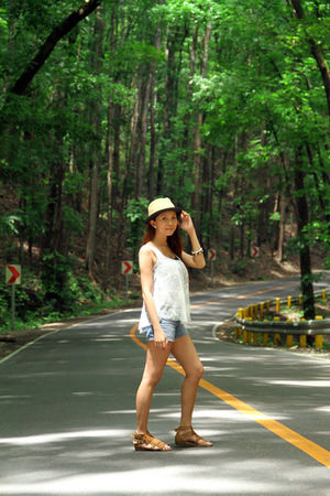 white top - beige hat - shorts - brown