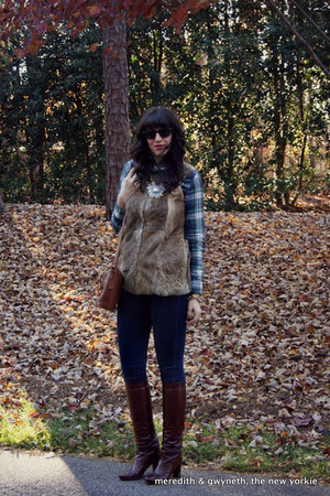 fur LaRok vest - leather stuart weitzman boots - skinny 7 for all mankind jeans