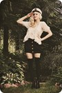 Ivory-vest-ivory-blouse-black-skirt