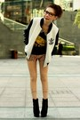 White-jacket-black-suede-lace-up-boots-gold-sequined-shorts