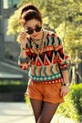 Black-cross-bracelet-red-sweater-light-orange-leather-viparo-shorts