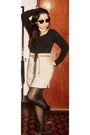 Black-hat-black-tights-beige-skirt-tawny-belt-black-top